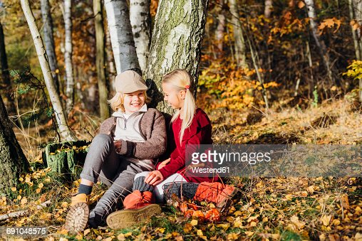 Hansel and Gretel, Boy and girl sitting in forest, talking