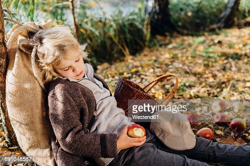 Hansel and Gretel, Boy in forest leaning against tree, sleeping