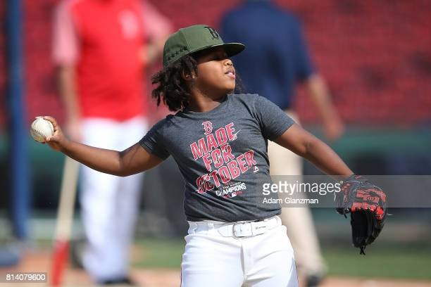 Hansel Ramirez son of Hanley Ramriez of the Boston Red Sox throws a ball before a game against the Los Angeles Angels of Anaheim at Fenway Park on...