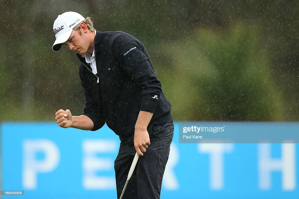 JB Hansen of Denmark celebrates securing par on the 17th hole during day three of the Perth International at Lake Karrinyup Country Club on October 19, 2013 in Perth, Australia.