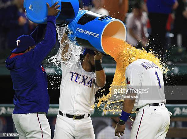 Hanser Alberto of the Texas Rangers and Rougned Odor of the Texas Rangers celebrate with Elvis Andrus of the Texas Rangers after the Rangers beat the...