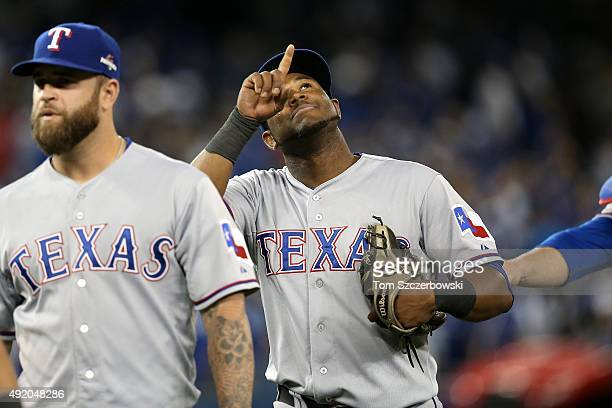 Hanser Alberto of the Texas Rangers celebrates after defeating the Toronto Blue Jays 64 during game two of the American League Division Series at...