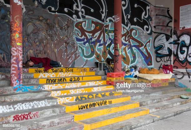 Hansestadt Hamburg that too is Hamburg Homeless man and graffiti in the Altona districtThe Red Flora Cathedral of the leftautonomous scene