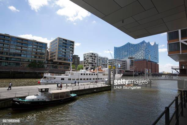 Hansestadt Hamburg the Hafencity living and working directly on the water In the background the Elbphilharmonie