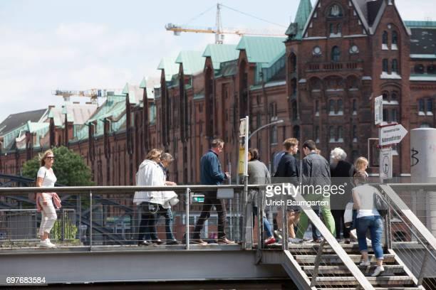 Hansestadt Hamburg tourists in front of the backdrop of Speicherstatdt