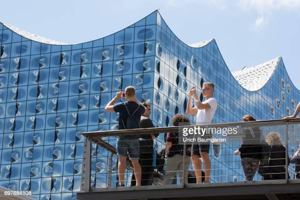 Hansestadt Hamburg tourists in front of the imposing Elbphilharmonie