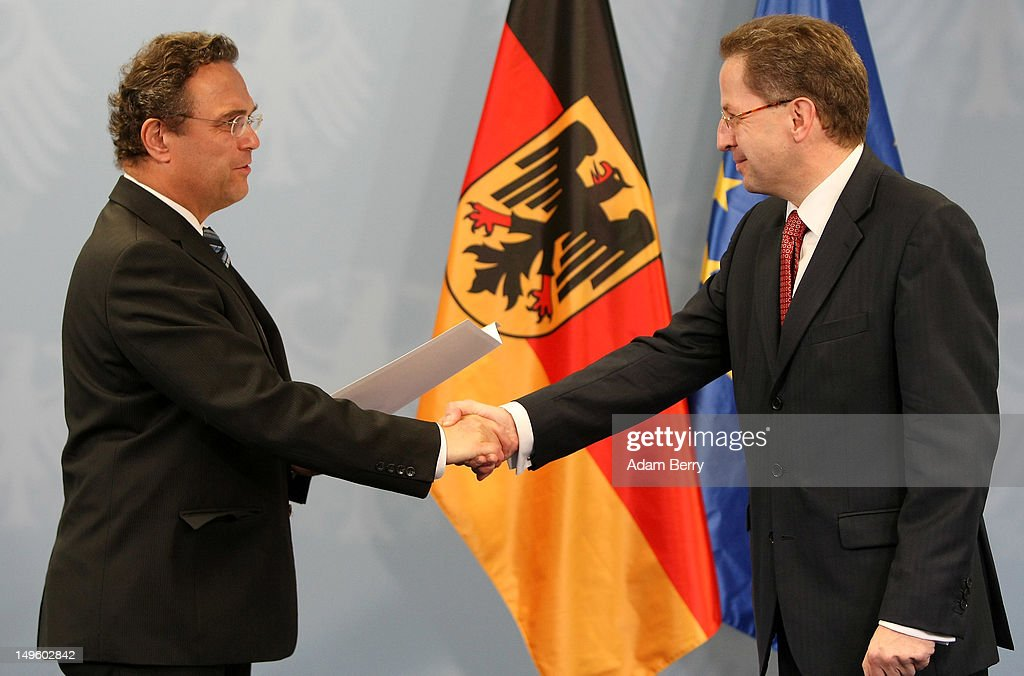 HansGeorg Maassen new president of the German Federal Office For Protection Of The Constitution is welcomed to his new position by German Minister...