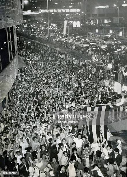 Hanshin Tigers fanatics celebrate the Nippon Professional Baseball champion after beating Seibu Lions at Hanshin Department store on November 2 1985...