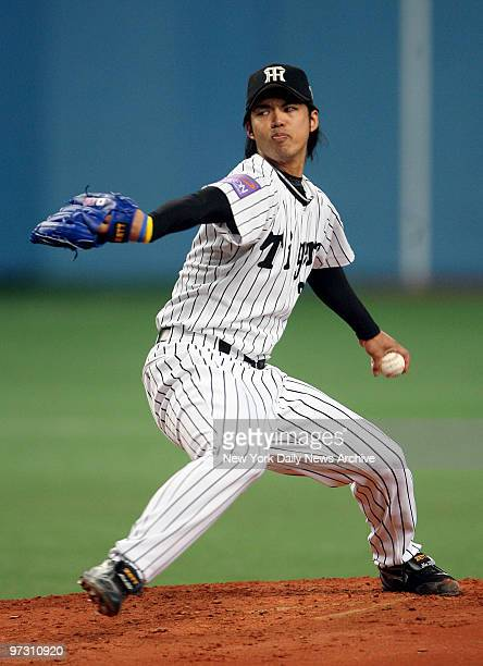 Hanshin Tigers' starter Kei Igawa delivers a pitch during the third inning of the fourth game between the Nippon Professional Baseball and Major...