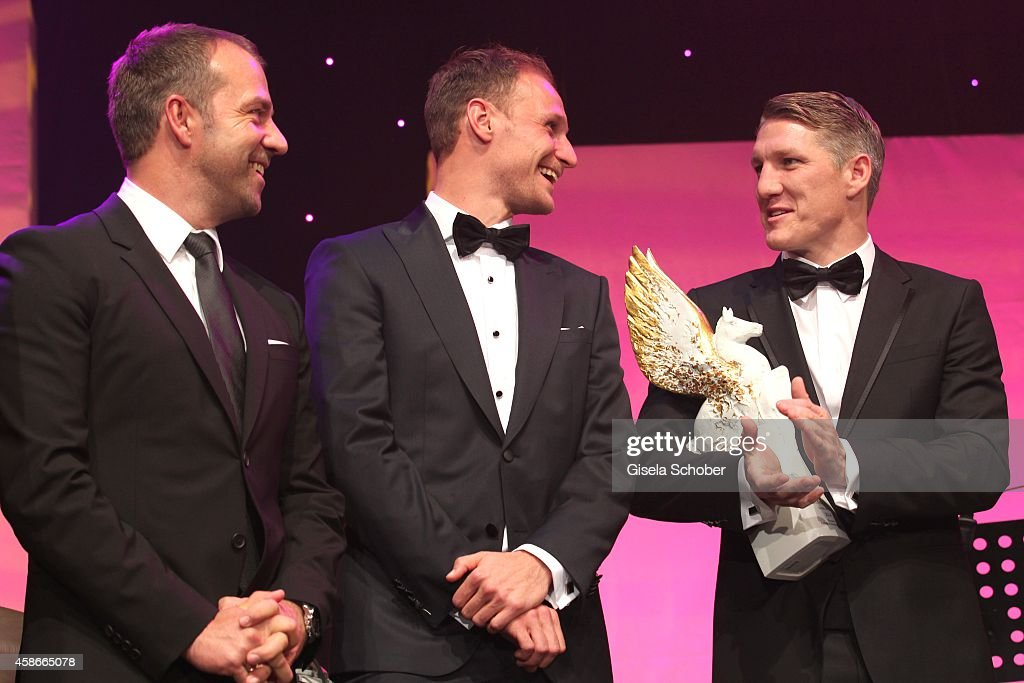 Hansi Flick, <a gi-track='captionPersonalityLinkClicked' href=/galleries/search?phrase=Benedikt+Hoewedes&family=editorial&specificpeople=3945465 ng-click='$event.stopPropagation()'>Benedikt Hoewedes</a>, <a gi-track='captionPersonalityLinkClicked' href=/galleries/search?phrase=Bastian+Schweinsteiger&family=editorial&specificpeople=203122 ng-click='$event.stopPropagation()'>Bastian Schweinsteiger</a> with Meissen Award 'Pegasos' during the 33. Deutscher Sportpresseball - German Sports Media Ball 2014 at Alte Oper on November 08, 2014 in Frankfurt, Germany.