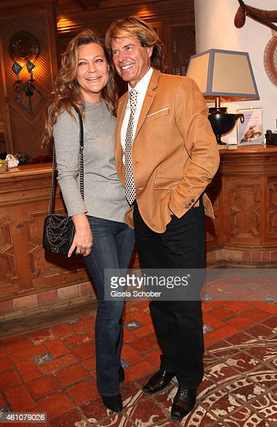 Hansi Hinterseer and his wife Romana pose during the NeujahrsKarpfenessen in Hotel zur Tenne on January 06 2015 in Kitzbuehel Austria