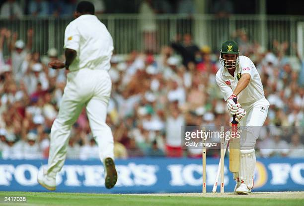 Hansie Cronje of South Africa is bowled by Devon Malcolm of England for a duck during the second innings of the Third test between England and South...