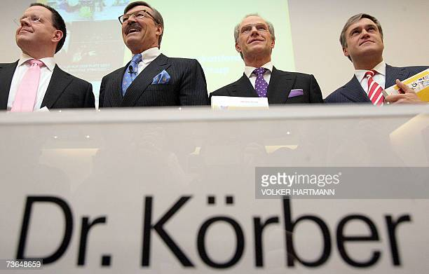 HansJoachim Koerber chairman of the German retail and distribution giant Metro poses with members of the board Thomas Unger Zygmunt Mierdorf and...