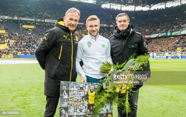 HansJoachim Watzke CEO of Borussia Dortmund and Director of Sports Michael Zorc saying goodbye to former player Jakob Kuba Blaszczykowski prior to...