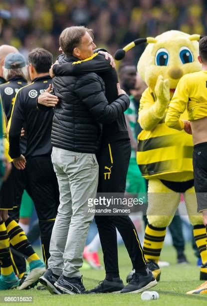 HansJoachim Watzke CEO of Borussia Dortmund celebrates the win together with head coach Thomas Tuchel after the final whistle during the Bundesliga...