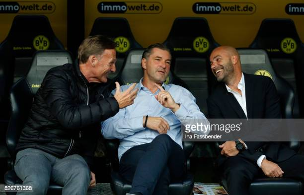 HansJoachim Watzke manager Michael Zorc und coach Peter Bosz of Dortmund talk before the DFL Supercup 2017 match between Borussia Dortmund and Bayern...