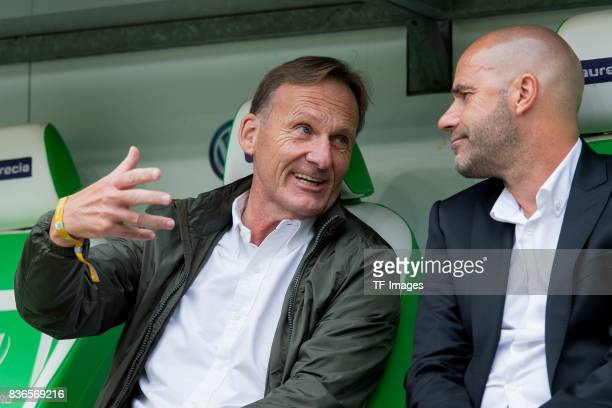 HansJoachim Watzke of Dortmund and Head coach Peter Bosz of Dortmund sits on the bench during to the Bundesliga match between VfL Wolfsburg and...