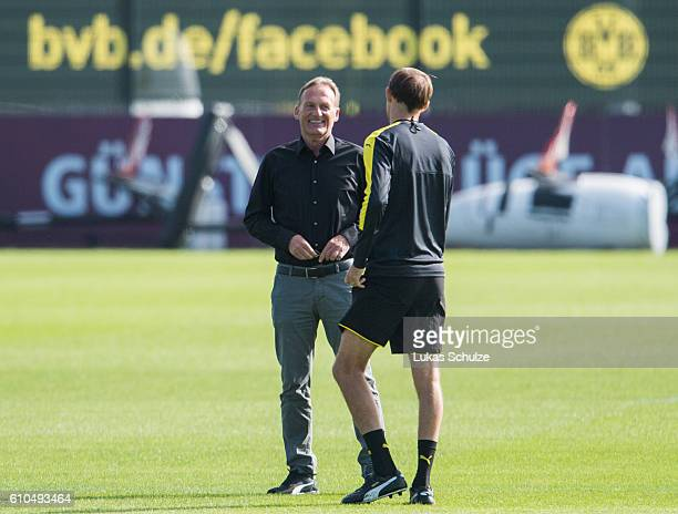 HansJoachim Watzke of Dortmund and Head Coach Thomas Tuchel of Dortmund are seen during a training session at Dortmund Brackel Training Ground on...