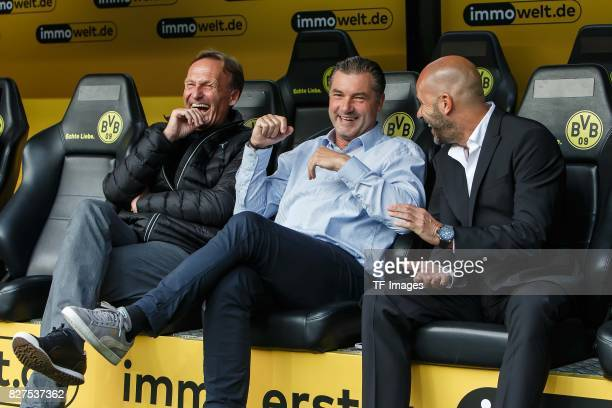 HansJoachim Watzke of Dortmund Michael Zorc of Dortmund and Head coach Peter Bosz of Dortmund laughs during the DFL Supercup 2017 match between...