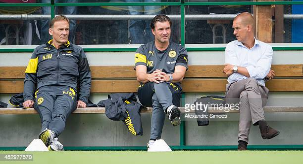 HansJoachim Watzke Sport Director Michael Zorc and Carsten Cramer Director of Sales and Marketing during day 3 of training camp on July 31 2014 in...