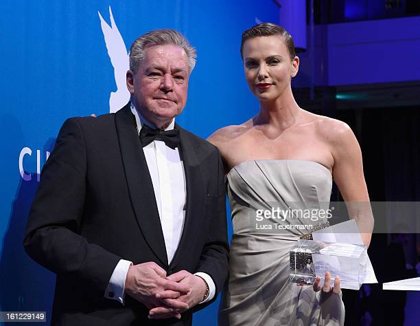 HansJuergen Beerfeltz and Charlize Theron during the Cinema For Peace Gala Ceremony at the 63rd Berlinale International Film Festival at the Waldorf...