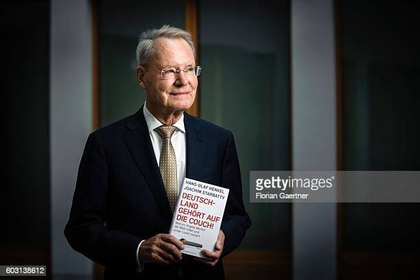 HansOlaf Henkel politician and author poses for a photo with his book 'Deutschland gehoert auf die Couch' on September 12 2016 in Berlin Germany