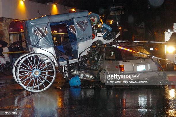 A hansom cab sits atop a station wagon following an accident at the intersection of W 50th St and Ninth Ave The spooked horse pulling the carriage...