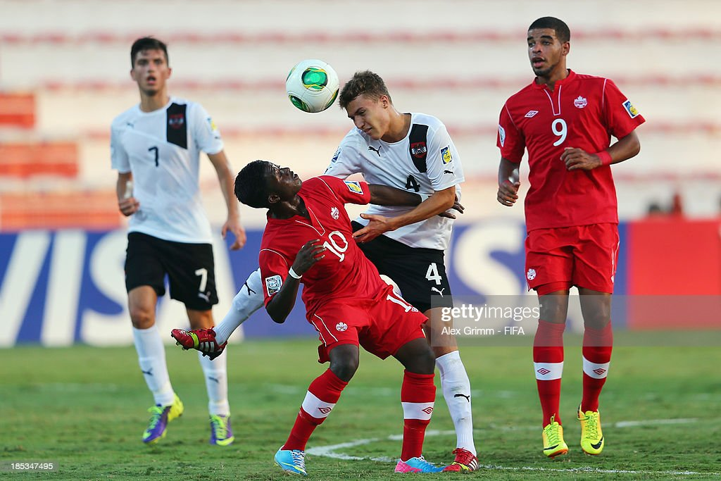 Hanson Boakai (front) of Canada is challenged by Lukas Tursch of Austria during the FIFA U-17 World Cup UAE 2013 Group E match between Canada and Austria at Al Rashid Stadium on October 19, 2013 in Dubai, United Arab Emirates.