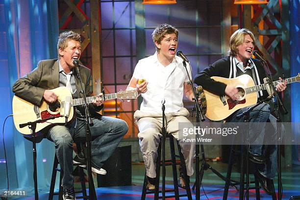 Hanson with band members Isaac Zac and Taylor perform on 'The Tonight Show with Jay Leno' at the NBC Studios on July 15 2003 in Burbank California