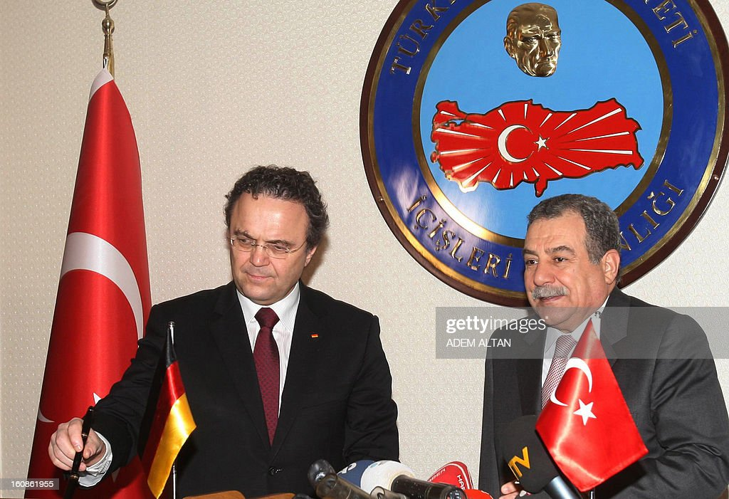 Hans-Peter Friedrich, German Federal Minister of the Interior, (L) and his Turkish counterpart Muammer Guler (R) hold a press conference after a meeting in Ankara, on February 7, 2013.