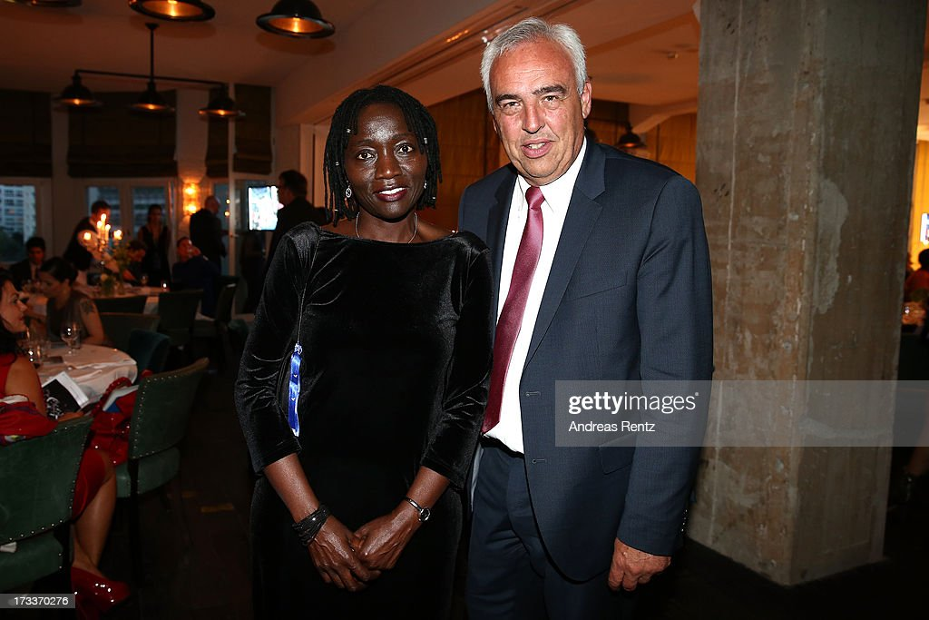 Hans-Reiner Schroeder and Auma Obama attend the Cinema for Peace UN women charity dinner at Soho House on July 12, 2013 in Berlin, Germany.