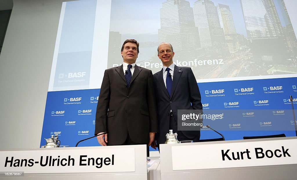 Hans-Ulrich Engel, chief financial officer of BASF SE, left, and Kurt Bock, chief executive officer of BASF SE, pose for a photograph ahead of a news conference to announce the company's results in Ludwigshafen, Germany, on Tuesday, Feb. 26, 2013. BASF SE forecast growth in earnings and sales this year after demand for plastics used to lighten cars and higher oil production buoyed quarterly earnings. Photographer: Ralph Orlowski/Bloomberg via Getty Images