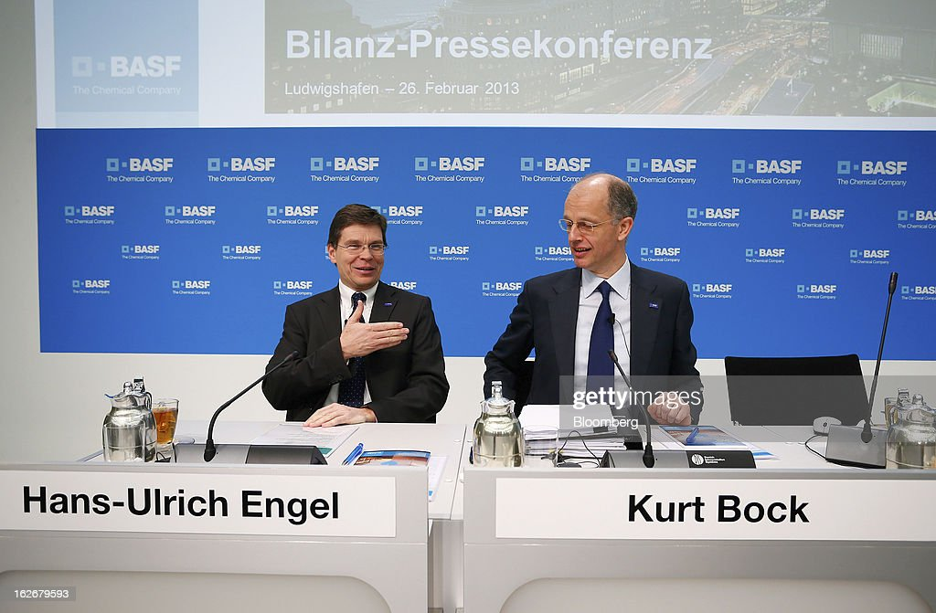 Hans-Ulrich Engel, chief financial officer of BASF SE, left, gestures as Kurt Bock, chief executive officer of BASF SE, reacts during a news conference to announce the company's results in Ludwigshafen, Germany, on Tuesday, Feb. 26, 2013. BASF SE forecast growth in earnings and sales this year after demand for plastics used to lighten cars and higher oil production buoyed quarterly earnings. Photographer: Ralph Orlowski/Bloomberg via Getty Images
