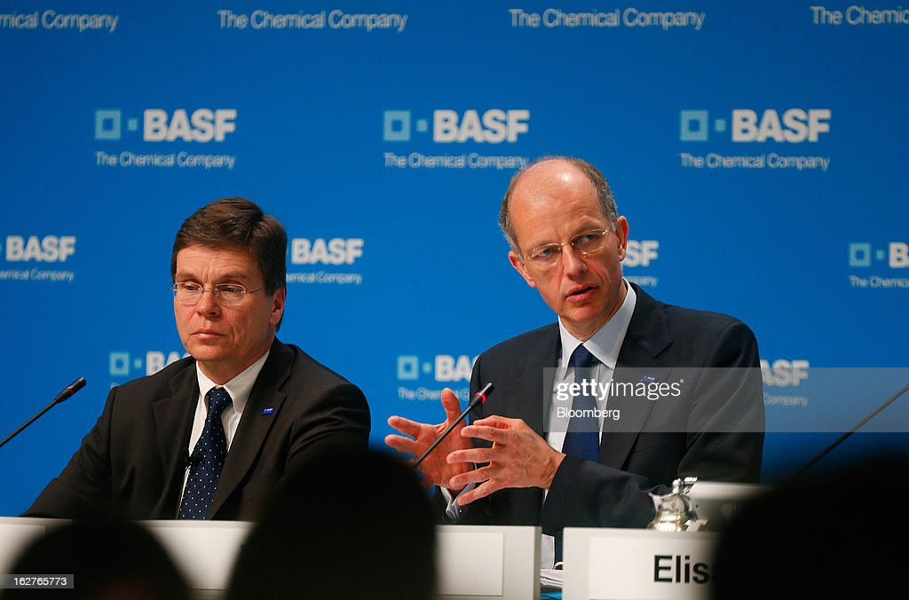 Hans-Ulrich Engel, chief financial officer of BASF SE, left, listens as Kurt Bock, chief executive officer of BASF SE, speaks during a news conference to announce the company's results in Ludwigshafen, Germany, on Tuesday, Feb. 26, 2013. BASF SE forecast growth in earnings and sales this year after demand for plastics used to lighten cars and higher oil production buoyed quarterly earnings. Photographer: Ralph Orlowski/Bloomberg via Getty Images