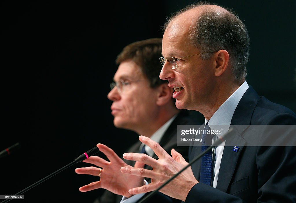 HansUlrich Engel chief financial officer of BASF SE left listens as Kurt Bock chief executive officer of BASF SE speaks during a news conference to...