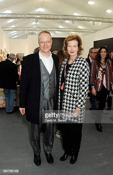 HansUlrich Obrist and Julia PeytonJones attend the VIP preview of the annual Frieze Art Fair in Regent's Park on October 16 2013 in London England