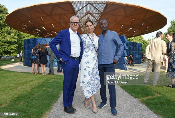 HansUlrich Obrist Artistic Director of the Serpentine Galleries Yana Peel CEO of the Serpentine Galleries and architect Francis Kere attend a...