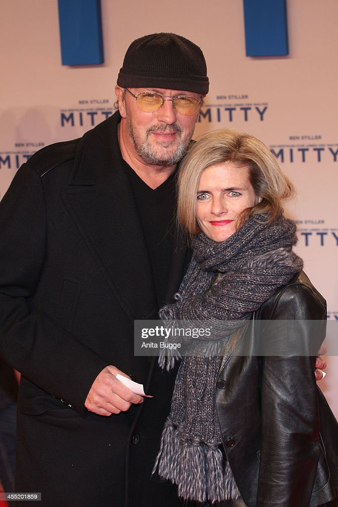 Hans-Werner Olm and Cornelia Utz attend the German premiere of the film 'The Secret Life Of Walter Mitty' (Das erstaunliche Leben des Walter Mitty) at Zoo Palast on December 11, 2013 in Berlin, Germany.