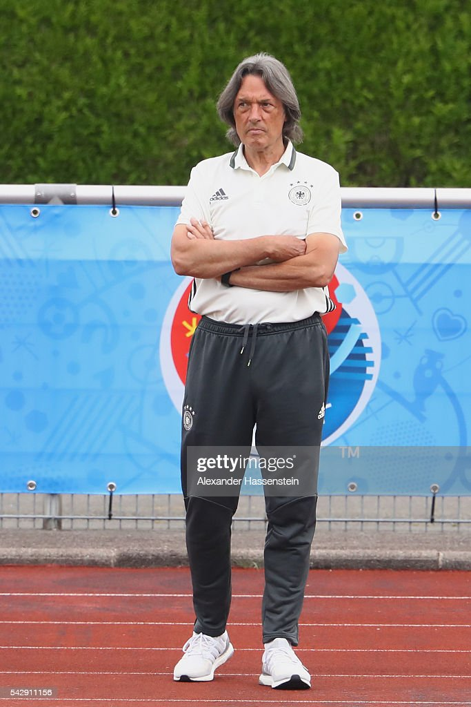 Hans-Wilhelm Mueller-Wohlfahrt team doctor of team Germany looks on during a Germany training session ahead of their Euro 2016 round of 16 match against Slovakia at Ermitage Evian on June 25, 2016 in Evian-les-Bains, France.