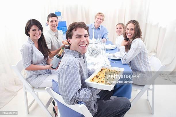 Hanukkah gathering with noodle kugel