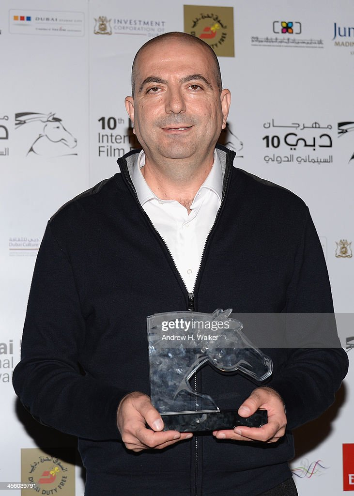Hany Abu Assad with his Arab Feature Best Director award at the Muhr Awards during day eight of the 10th Annual Dubai International Film Festival held at the Madinat Jumeriah Complex on December 13, 2013 in Dubai, United Arab Emirates.