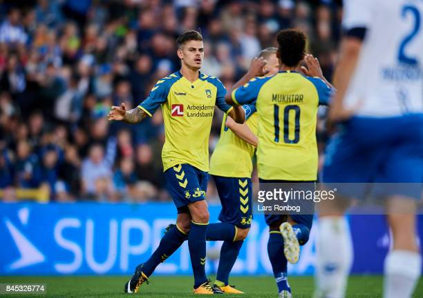 Hany Mukhtar and Jan Kliment of Brondby IF celebrate after scoring their first goal during the Danish Alka Superliga match between OB Odense and...