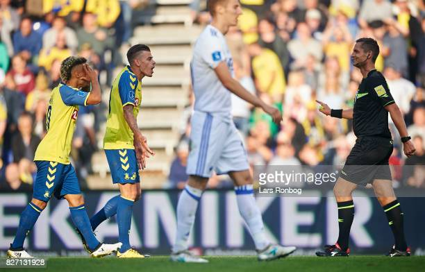 Hany Mukhtar and Jan Kliment of Brondby IF shows frustration against Referee Anders Poulsen during the Danish Alka Superliga match between Brondby IF...