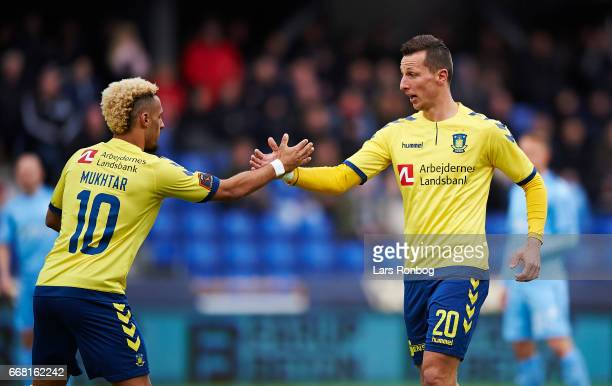 Hany Mukhtar and Kamil Wilczek of Brondby IF celebrate after scoring their first goal during the Danish Cup DBU Pokalen quarterfinal match between...