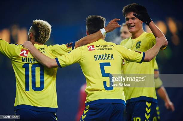 Hany Mukhtar Gregor Sikosek and Christian Norgaard of Brondby IF celebrate after scoring their first goal during the Danish Alka Superliga match...