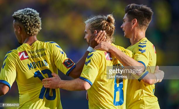 Hany Mukhtar Kasper Fisker and Gregor Sikosek of Brondby IF celebrate after scoring their second goal during the UEFA Europa League Qualification...