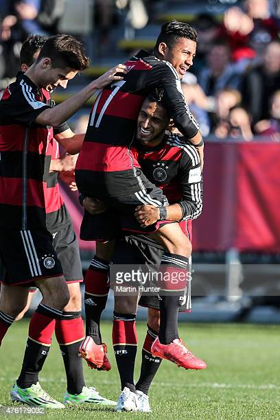 Hany Mukhtar lifts Jeremy Dudziak of Germany after scoring a goal during the FIFA U20 World Cup New Zealand 2015 Group F match between Honduras and...