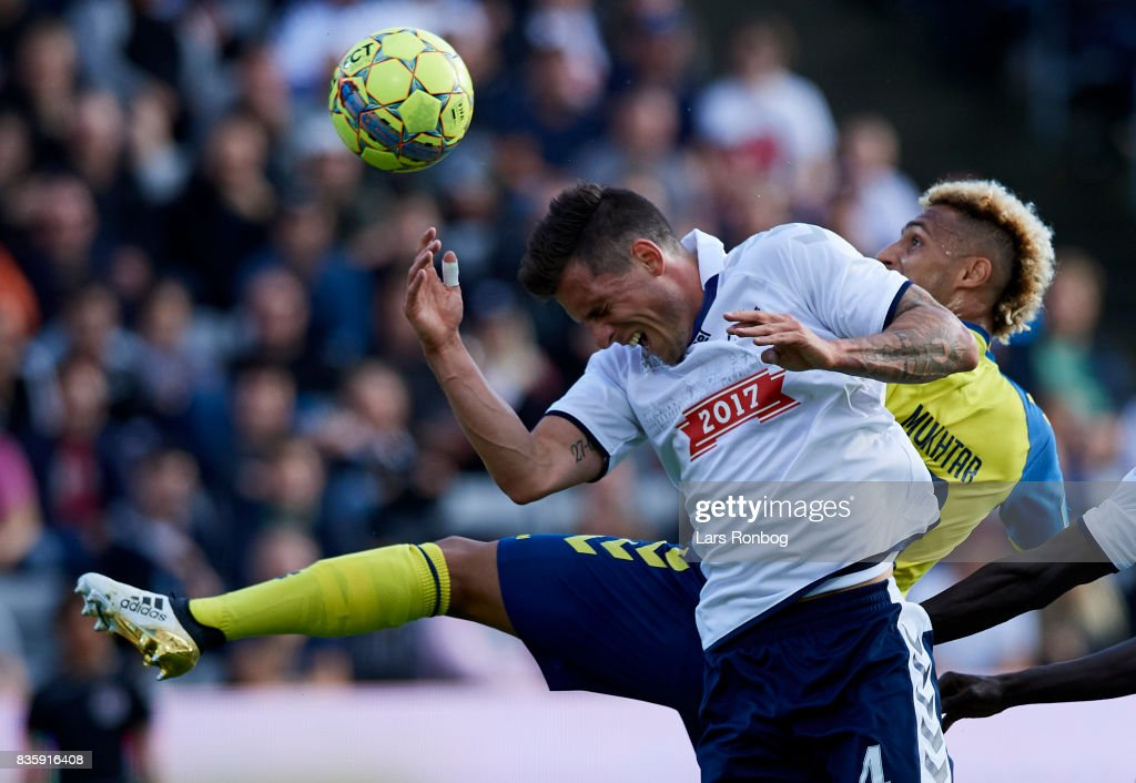 Hany Mukhtar of Brondby IF and Daniel A. Pedersen of AGF Aarhus compete for the ball during the Danish Alka Superliga match between AGF Aarhus and Brondby IF at Ceres Park on August 20, 2017 in Aarhus, Denmark.