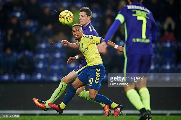 Hany Mukhtar of Brondby IF and Jonas Borring of FC Midtjylland compete for the ball during the Danish Alka Superliga match between Brondby IF and FC...