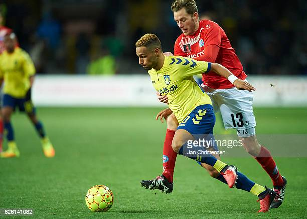 Hany Mukhtar of Brondby IF and Mikkel Vendelbo of Silkeborg IF compete for the ball during the Danish Alka Superliga match between Brondby IF and...